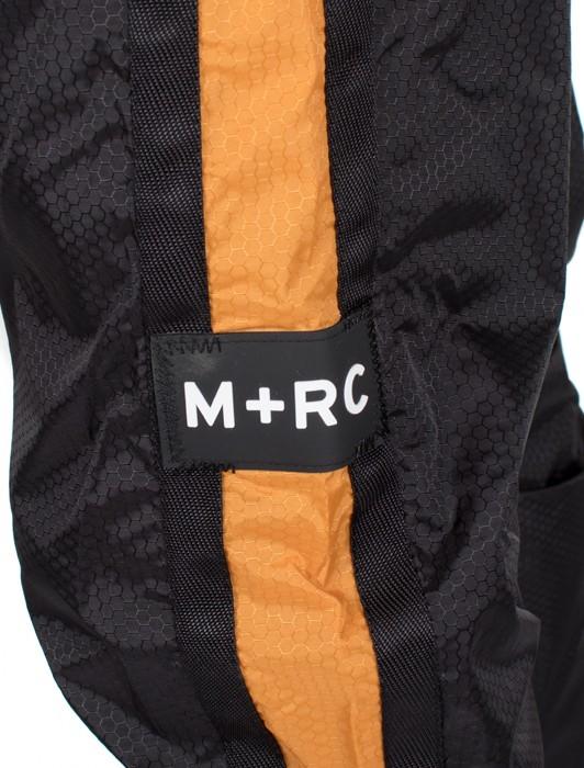 M+RC NOIR PLUG TRACK PANT BLACK AND ORANGE